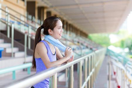 take a break: Happy girl take a break after running in sport arena Stock Photo