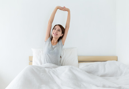 up wake: Woman just wake up with hand stretching