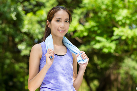 sport wear: Woman with sport wear and blue towel at park