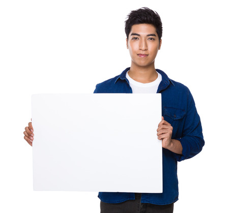 white poster: Man showing the white board