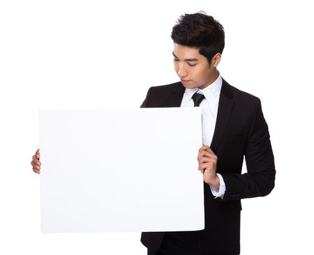 a placard: Businessman show with the placard Stock Photo