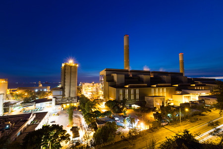 cement chimney: Coal power station and cement plant at night