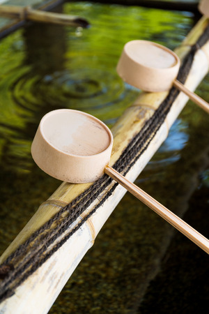 bamboo fountain: Traditional Japanese bamboo fountain dripping water Stock Photo