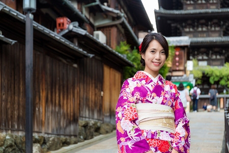 traditional clothes: Young woman with traditional clothes in Kyoto Stock Photo