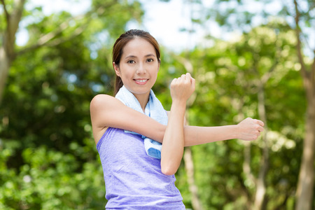 women sport: Woman doing warm up exercise, stretching on hand Stock Photo