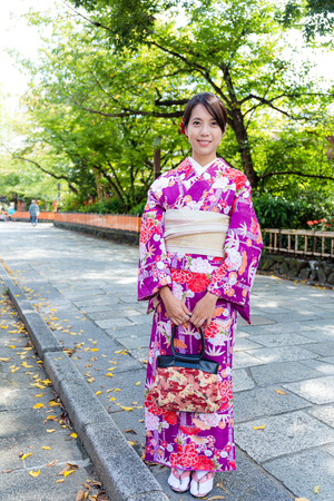 though: Japanese woman walking though the Kyoto street