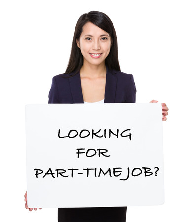 looking for job: Asian businesswoman holding a poster showing with looking for part-time job phrases Stock Photo
