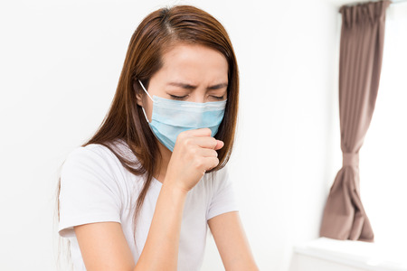 Woman feeling unwell at home Stock Photo