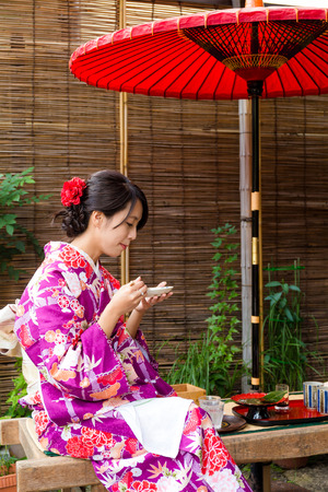 tea house: Young woman having the dessert in tea house