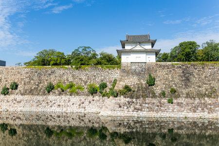 osakajo: Reflection in the Moat with a Turret of Osaka Castle in Osaka, Japan