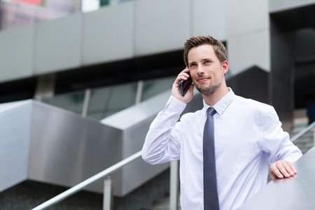 building planners: Young businessman talk to cellphone at outdoor