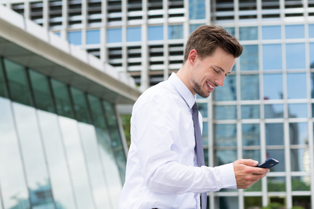 american banker: Young businessman use of the mobile phone