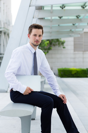 american banker: Caucasian young businessman hold with laptop computer at hong kong