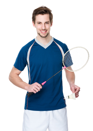 racket sport: Caucasian Badminton player with shuttlecock and racket