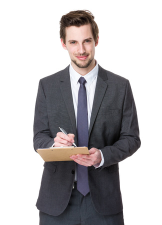 american banker: Businessman take note on clipboard Stock Photo