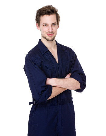boiler suit: Smiling young mechanic in boiler suit Stock Photo