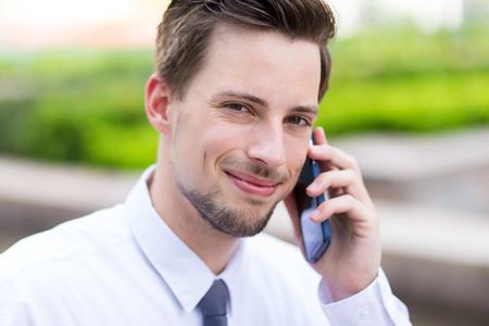 american banker: Caucasian young businessman chat on mobile phone