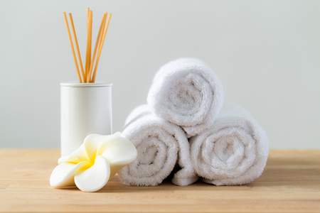 white towels: Tropical flowers frangipani with Scented woods and white towel for thai massage