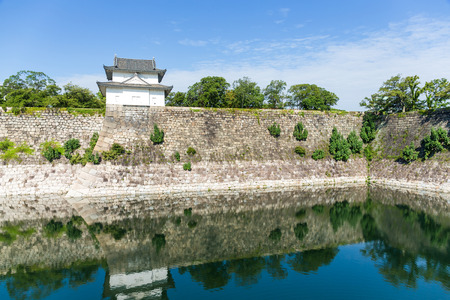 turret: Moat with a Turret of Osaka Castle in Osaka, Japan Editorial
