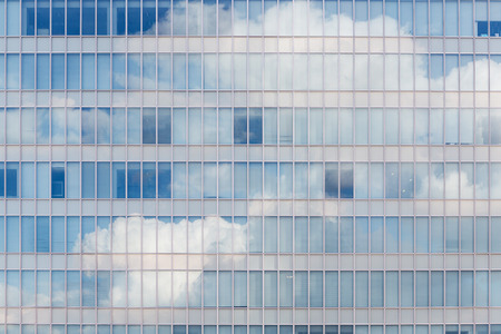 sky reflection: Cloud reflected in windows of modern office building