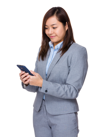 telephone saleswoman: Asian businesswoman use of mobile phone