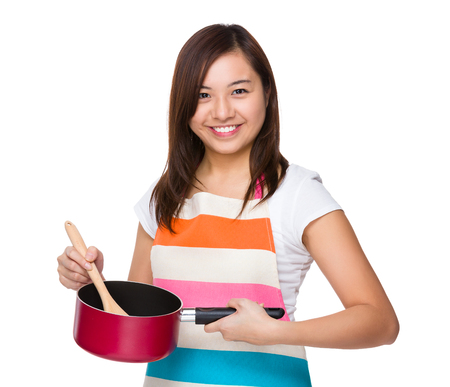 saucepan: Housewife cooking with saucepan