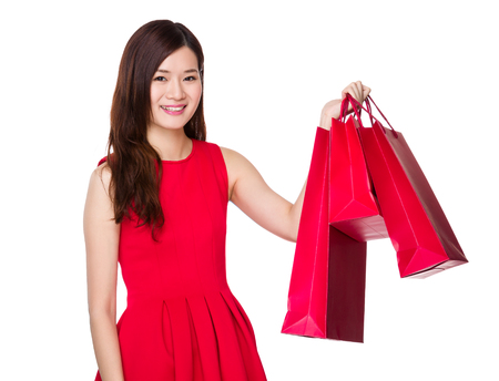 traditonal: Woman with chinese traditonal costume hold with shopping bag Stock Photo