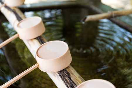 purification: Traditional purification ladles at entrance to Japanese temple
