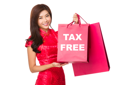 celebrate year: Chinese Woman hold with red paper bag and showing tax free Stock Photo