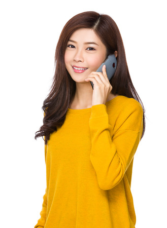 woman on phone: Asian young woman chat on mobile phone