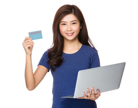 causal: Woman hold with laptop and credit card