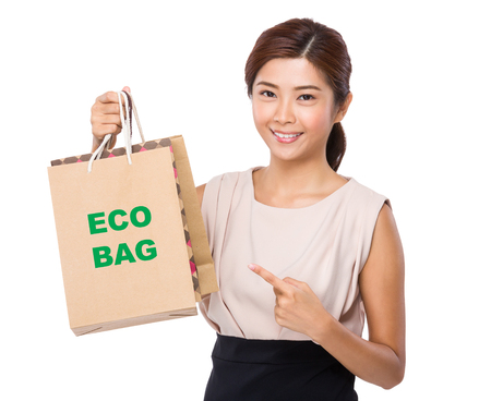 protecting your business: Asian woman finger point to shopping bag and showing phrase of eco bag