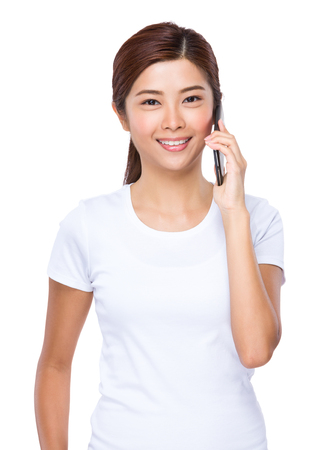 woman on phone: Young woman talk to mobile phone