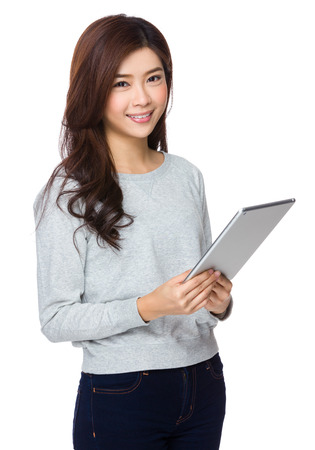sweatsuit: Asian Woman hold with tablet pc