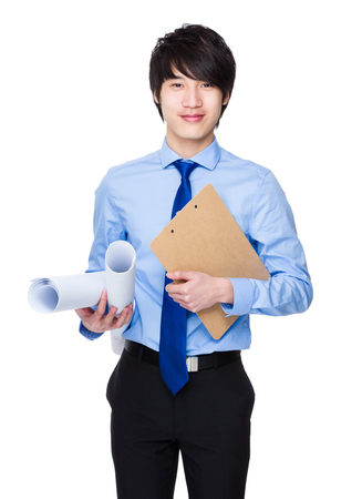 Engineer hold with blue print and clipboard Stock Photo