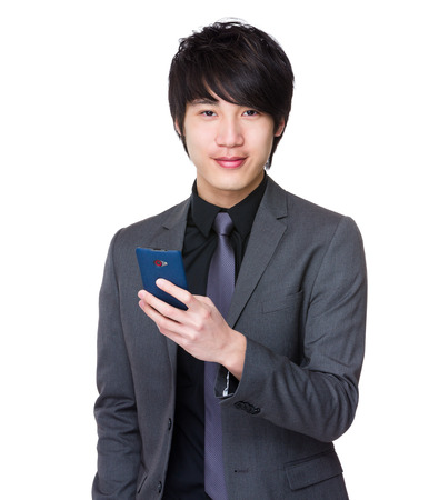telephone saleswoman: Asian businessman use of the cellphone