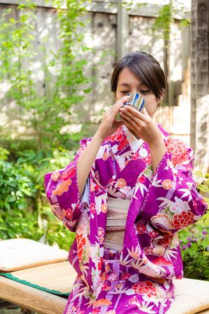 tea house: Woman with kimono dress and drink of the tea in tea house Stock Photo