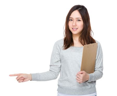 sweatsuit: Young Woman hold with clipboard and finger point aside