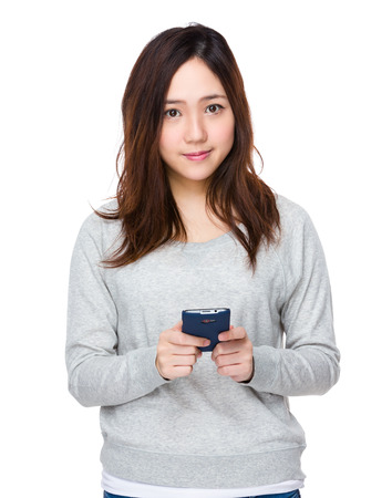 sweatsuit: Young woman use of the cellphone