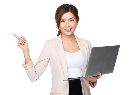 notebook computer: Businesswoman hold with notebook computer and finger point up