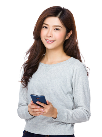 sweatsuit: Asian young woman use of the mobile phone