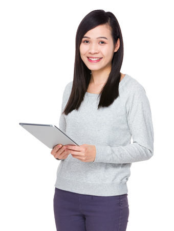 sweatsuit: Young Woman use of the tablet pc