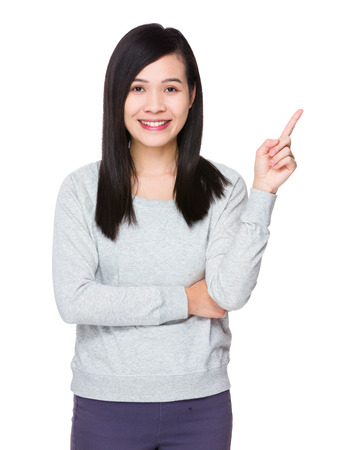 sweatsuit: Young Woman with finger point up Stock Photo