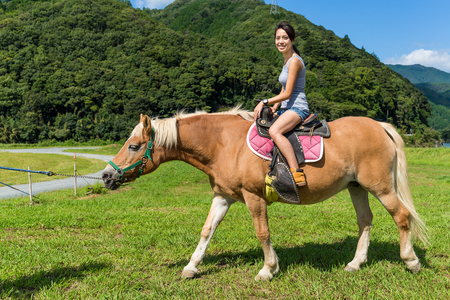 ride: Woman riding horse