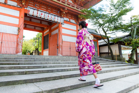 though: Woman wear with kimono walking though the step in temple Stock Photo