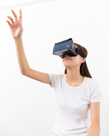 Young woman experience though the visual reality device