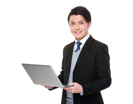 notebook computer: Asian young businessman use of the notebook computer