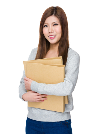 sweatsuit: Asian Woman hold with folder Stock Photo