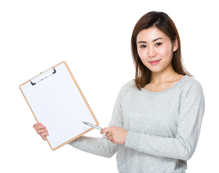 Woman with pen point to clipboard Stock Photo