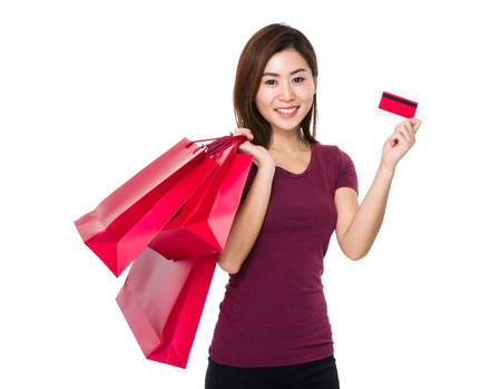 credit card bills: Woman hold with shopping bag and credit card